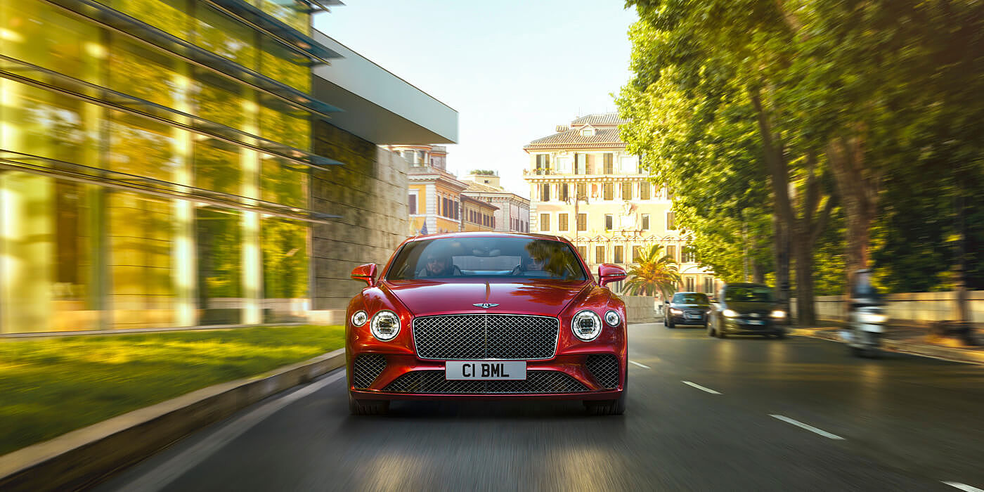 BENTLEY-CONTINENTAL-GT-V8-DRIVING-PAST-CITY-PARK